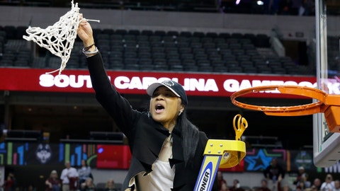 South Carolina coach Dawn Staley cuts down the net as she and the team celebrate their win over Mississippi State in the final of NCAA women's Final Four college basketball tournament, Sunday, April 2, 2017, in Dallas. South Carolina won 67-55. (AP Photo/LM Otero)