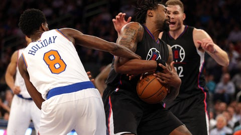 DeAndre Jordan wearing the device under a wristband during a game against the Knicks
