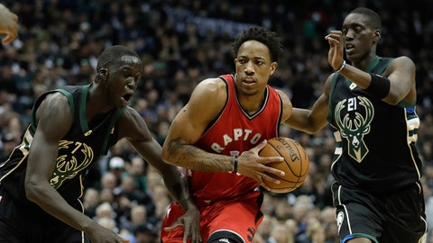 Toronto Raptors' DeMar DeRozan drives past Milwaukee Bucks' Tony Snell and Thon Maker during the first half of game 3 of their NBA first-round playoff series basketball game Thursday, April 20, 2017, in Milwaukee. (AP Photo/Morry Gash)