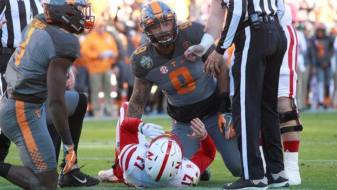NASHVILLE, TN - DECEMBER 30: Tennessee Volunteers defensive end Derek Barnett (9) and Tennessee Volunteers defensive lineman Jonathan Kongbo (1) after sacking Nebraska Cornhuskers quarterback Ryker Fyfe (17) during the Music City Bowl game between the Nebraska Cornhuskers and the Tennessee Volunteers on December 30, 2016 at Nissan Stadium in Nashville, TN. Tennessee defeated Nebraska 38-24. (Photo by Charles Mitchell/Icon Sportswire)