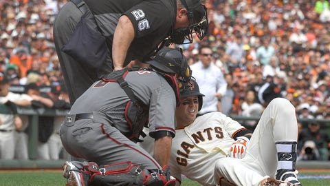 Fastball hits Posey in the helmet