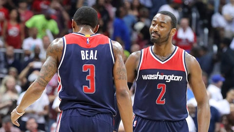 Washington Wizards' John Wall, right, and Bradley Beal celebrate a victory over the Atlanta Hawks in Game 6 of a first-round NBA basketball playoff series on Friday, April 28, 2017, in Atlanta. (Curtis Compton/Atlanta Journal-Constitution via AP)