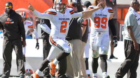Cleveland Browns quarterback Johnny Manziel (2) celebrates after throwing a 50-yard touchdown pass to Travis Benjamin in the second half of an NFL football game against the Tennessee Titans, Sunday, Sept. 20, 2015, in Cleveland. (AP Photo/David Richard)