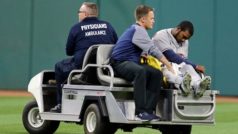 Houston Astros' Teoscar Hernandez is carted off the field in the eighth inning of a baseball game against the Cleveland Indians, Tuesday, April 25, 2017, in Cleveland. Hernandez collided with Jose Altuve. (AP Photo/Tony Dejak)