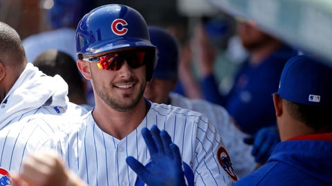 CHICAGO, IL - APRIL 15: Kris Bryant #17 of the Chicago Cubs is congratulated in the dugout after hitting a two run home run against the Pittsburgh Pirates during the second inning at Wrigley Field on April 15, 2017 in Chicago, Illinois. All players are wearing #42 in honor of Jackie Robinson Day.  (Photo by Jon Durr/Getty Images)
