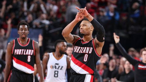 PORTLAND, OR - APRIL 8: Damian Lillard #0 of the Portland Trail Blazers celebrates after scoring 59 points against the Utah Jazz on April 8, 2017 at the Moda Center in Portland, Oregon. NOTE TO USER: User expressly acknowledges and agrees that, by downloading and or using this Photograph, user is consenting to the terms and conditions of the Getty Images License Agreement. Mandatory Copyright Notice: Copyright 2017 NBAE (Photo by Sam Forencich/NBAE via Getty Images)