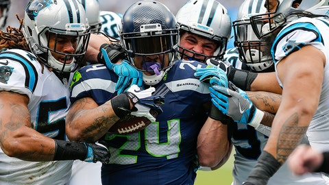 """Jan 17, 2016: Seattle Seahawks running back Marshawn Lynch (24) is out """"beast mode"""" by the Carolina Panthers defense during the NFC Divisional Playoff game between the Carolina Panthers and the Seattle Seahawks at Bank of America Stadium in Charlotte, NC. (Photo by Jim Dedmon/ Icon Sportswire)"""