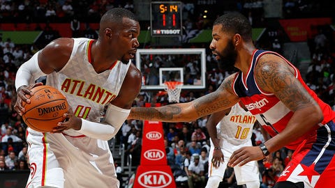 ATLANTA, GA - OCTOBER 27:  Paul Millsap #4 of the Atlanta Hawks looks to drive against Markieff Morris #5 of the Washington Wizards at Philips Arena on October 27, 2016 in Atlanta, Georgia.  NOTE TO USER User expressly acknowledges and agrees that, by downloading and or using this photograph, user is consenting to the terms and conditions of the Getty Images License Agreement.  (Photo by Kevin C. Cox/Getty Images)