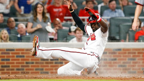 Apr 20, 2017; Atlanta, GA, USA; Atlanta Braves second baseman Brandon Phillips (4) scores a run against the Washington Nationals in the fourth inning at SunTrust Park. Mandatory Credit: Brett Davis-USA TODAY Sports