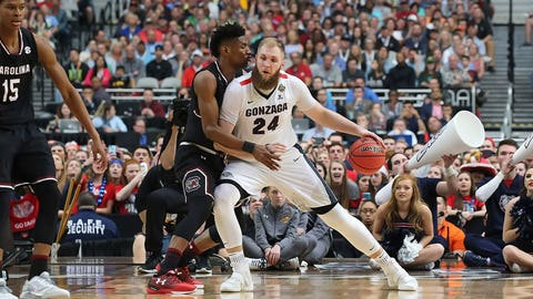Gonzaga's Przemek Karnoski tries to back down the South Carolina defense.