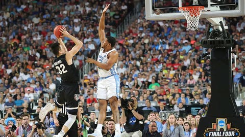 Kennedy Meeks gets a long arm in the way of Zach Collins' jumper.
