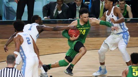 Dillon Brooks barrels toward the basket.