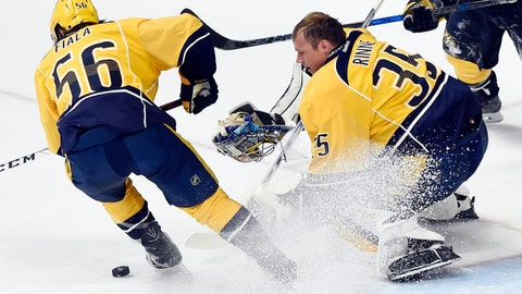 Nashville Predators goalie Pekka Rinne (35), of Finland, mask falls off after stopping a shot against the Minnesota Wild during the second period of an NHL hockey game Saturday, April 1, 2017, in Nashville, Tenn. (AP Photo/Mark Zaleski)