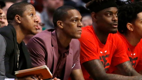 With a cast on his right thumb, Chicago Bulls' Rajon Rondo, center, sits on the bench during Game 3 of the team's NBA basketball first-round playoff series against the Boston Celtics in Chicago, Friday, April 21, 2017. (AP Photo/Charles Rex Arbogast)