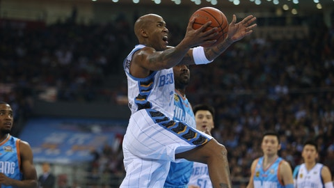 """--FILE--Former NBA star Stephon Marbury of Beijing Ducks Basketball Club prepares to dunk against Xinjiang Flying Tigers Basketball Club during a 4th round match of the 2015-2016 CBA Season in Beijing, China, 21 February 2016.  Stephon Marbury, the biggest former NBA star currently playing for a Chinese professional basketball team, will make his cinematic debut as the lead character in """"My Other Home,"""" a Chinese film that revolves around his life story. Marbury, who was nicknamed """"Lone Wolf"""" for his style on the court during his NBA career, now plays for the Beijing Ducks, a professional basketball team based in the Chinese capital. He led the team to its first Chinese Basketball Association championship in 2012 and another two championships in 2014 and 2015. Since moving to China in 2010, Marbury has won the adoration of Chinese basketball fans, particularly in Beijing, where he has also been honored as a """"role model"""" by the local government."""