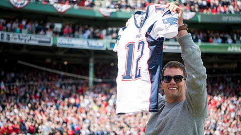 BOSTON, MA - APRIL 03:  Tom Brady #12 of the New England Patriots holds up his recovered jersey during a ceremony honoring the Super Bowl champions at Fenway Park before an opening gay game between the Boston Red Sox and the Pittsburgh Pirates on April 3, 2017 in Boston, Massachusetts. (Photo by Michael Ivins/Boston Red Sox/Getty Images)