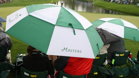 AUGUSTA, GA - APRIL 03:  Patrons use an umbrealla next to the 16th green during a practice round prior to the start of the 2017 Masters Tournament at Augusta National Golf Club on April 3, 2017 in Augusta, Georgia.  (Photo by Rob Carr/Getty Images)