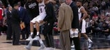 Spurs' Parker carried off with apparent left knee injury