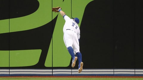 TORONTO, ON - MAY 8: Kevin Pillar #11 of the Toronto Blue Jays makes an inning-ending diving catch to end the sixth inning during MLB game action against the Cleveland Indians at Rogers Centre on May 8, 2017 in Toronto, Canada. (Photo by Tom Szczerbowski/Getty Images)