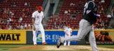 Rockies take opener in Cincinnati 12-6 over Reds
