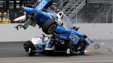 Scott Dixon's car crashes over the top of Jay Howard at the Indianapolis 500. (AP Photo/Marty Seppala)