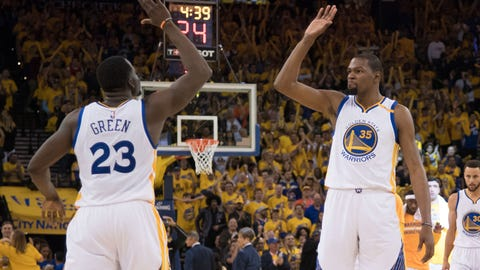 April 16, 2017; Oakland, CA, USA; Golden State Warriors forward Kevin Durant (35) celebrates with forward Draymond Green (23) during the fourth quarter in game one of the first round of the 2017 NBA Playoffs against the Portland Trail Blazers at Oracle Arena. The Warriors defeated the Trail Blazers 121-109. Mandatory Credit: Kyle Terada-USA TODAY Sports