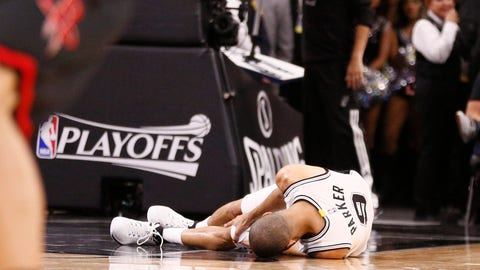 May 3, 2017; San Antonio, TX, USA; San Antonio Spurs point guard Tony Parker (9) rests on the court after being injured against the Houston Rockets during the second half in game two of the second round of the 2017 NBA Playoffs at AT&T Center. Mandatory Credit: Soobum Im-USA TODAY Sports