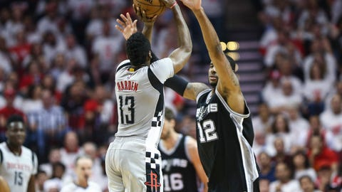 May 7, 2017; Houston, TX, USA; Houston Rockets guard James Harden (13) makes a three point basket as San Antonio Spurs forward LaMarcus Aldridge (12) defends during the third quarter in game four of the second round of the 2017 NBA Playoffs at Toyota Center. Mandatory Credit: Troy Taormina-USA TODAY Sports