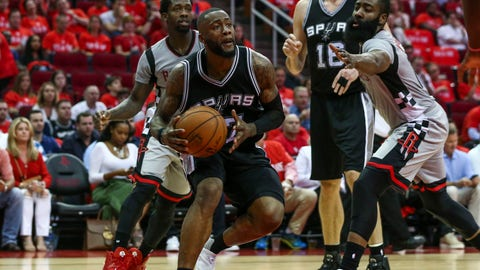 May 11, 2017; Houston, TX, USA; San Antonio Spurs guard Jonathon Simmons (17) dribbles the ball during the third quarter against the Houston Rockets in game six of the second round of the 2017 NBA Playoffs at Toyota Center. Mandatory Credit: Troy Taormina-USA TODAY Sports