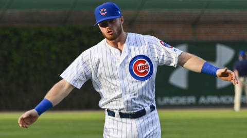 May 17, 2017; Chicago, IL, USA; Chicago Cubs center fielder Ian Happ (8) stretches before the game against the Cincinnati Reds  at Wrigley Field. Mandatory Credit: Matt Marton-USA TODAY Sports