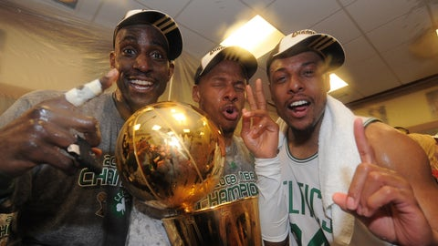 BOSTON - JUNE 17: Kevin Garnett #5, Ray Allen #20 and Paul Pierce #34 of the Boston Celtics pose for a photo with the NBA Champion trophy after defeating the Los Angeles Lakers during Game Six of the NBA Finals at the TD Banknorth Garden on June 17, 2008 in Boston, Massachusetts. NOTE TO USER: User expressly acknowledges and agrees that, by downloading and or using this photograph, User is consenting to the terms and conditions of the Getty Images License Agreement. Mandatory Copyright Notice: Copyright 2008 NBAE (Photo by Brian Babineau/NBAE via Getty Images)