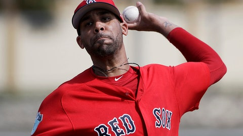 FILE - In this Feb. 19, 2017, file photo, Boston Red Sox pitcher David Price throws a live batting session at a spring training baseball workout in Fort Myers, Fla. Price is likely to start the season on the disabled list because of his sore pitching elbow. Starting the second season of a $217 million, seven-year contract, Price has not yet appeared in an exhibition game.  (AP Photo/David Goldman, File)