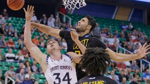 Virginia Commonwealth forward Ahmed Hamdy-Mohamed, rear, blocks the shot of Saint Mary's center Jock Landale (34) during the first half of a first-round game in the NCAA mens' college basketball tournament Thursday, March 16, 2017, in Salt Lake City. (AP Photo/Rick Bowmer)