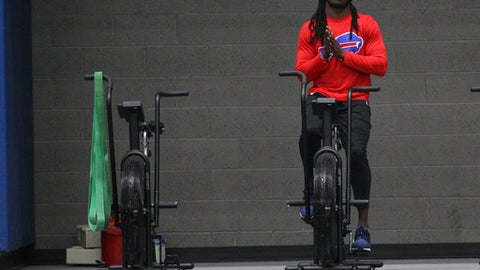 Buffalo Bills reciever Sammy Watkins rides a stationary bike during the first day of voluntary off season conditioning, Monday, April 3, 2017, in Orchard Park, N.Y. (AP Photo/Jeffrey T. Barnes)