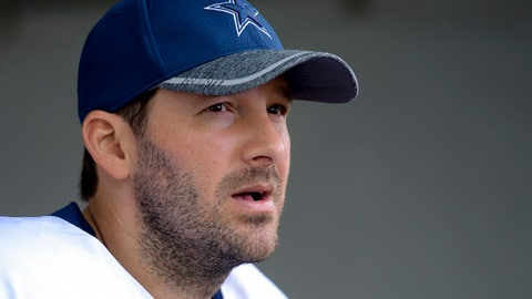 FILE - In this Aug. 1, 2016, file photo, Dallas Cowboys quarterback Tony Romo takes to reporters at the end of practice in Oxnard, Calif. A person with knowledge of the decision says Romo is retiring rather than trying to chase a Super Bowl with another team after losing his starting job with the Dallas Cowboys. The all-time passing leader for the storied franchise is headed to the broadcast booth after considering those offers. The person spoke to The Associated Press on condition of anonymity Tuesday, April 4, 2017, because Romo's decision hasn't been announced. (AP Photo/Gus Ruelas, File)