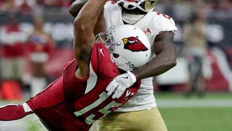 FILE - In this Nov. 13, 2016, file photo, Arizona Cardinals wide receiver Michael Floyd (15) cannot make the catch as San Francisco 49ers cornerback Tramaine Brock defends during the second half of an NFL football game in Glendale, Ariz. Police reported Friday, April 7, 2017, that Brock was arrested in Santa Clara, Calif., Thursday night after being accused of hitting a woman he was dating. (AP Photo/Rick Scuteri, File)