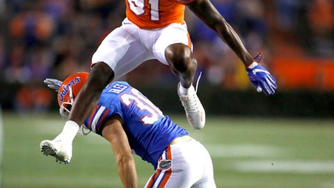 Florida wide receiver Antonio Callaway (81) hurdles defender Eddie Giles (36) during the NCAA college football team's spring game Friday, April 7, 2017, in Gainesville, Fla. [Brad McClenny/The Gainesville Sun via AP)