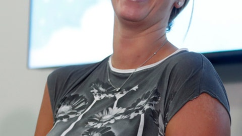 Czech Republic's tennis player Petra Kvitova smiles while holding a statement for media in Prague, Czech Republic, Friday, Dec. 23, 2016. Two-time Wimbledon champion was injured Tuesday Dec. 20, 2016 when a knife-wielding intruder attacked her at her home in the town of Prostejov. Kvitova underwent nearly four hour surgery on her left hand. (AP Photo/Petr David Josek)