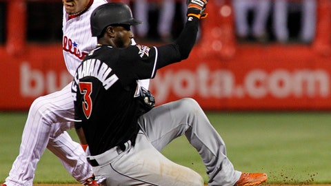 Miami Marlins' Adeiny Hechavarria gets back to second safely as Philadelphia Phillies' Maikel Franco is late with the tag after a line drive hit by Marlins' Suzukii Ichiro was caught during the seventh inning of a baseball game Wednesday, April 26, 2017, in Philadelphia. The Phillies won 7-4. (AP Photo/Tom Mihalek)