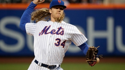"FILE - In this April 20, 2017, file photo, New York Mets' Noah Syndergaard delivers a pitch during the first inning of a baseball game against the Philadelphia Phillies, in New York. Syndergaard was scratched from his start Thursday, April 27, 2017, against the Atlanta Braves because of what manager Terry Collins said was ""minor discomfort"" in his bicep.(AP Photo/Frank Franklin II, File)"
