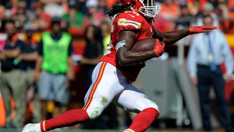 FILE- In this Oct. 11, 2015, file photo, Kansas City Chiefs running back Jamaal Charles carries the ball during the second half of an NFL football game against the Chicago Bears in Kansas City, Mo. Charles is scheduled to visit with the Denver Broncos on Tuesday, May 2, 2017. If his surgically repaired right knee checks out, Charles could be joining their fierce divisional rival.  (AP Photo/Ed Zurga, File)