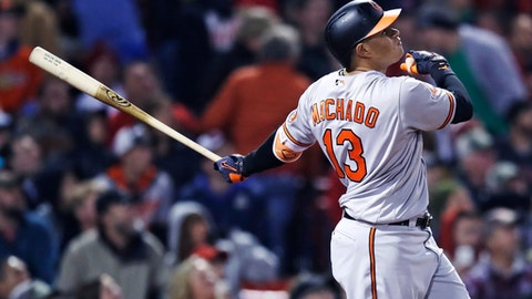 Baltimore Orioles' Manny Machado watches the flight of his solo home run off Boston Red Sox starting pitcher Rick Porcello during the sixth inning of a baseball game at Fenway Park in Boston, Monday, May 1, 2017. (AP Photo/Charles Krupa)