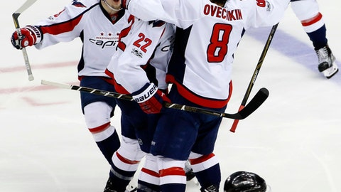 Washington Capitals' Kevin Shattenkirk (22) celebrates with Dmitry Orlov (9), and Alex Ovechkin (8) after score the game-winning goal in overtime of Game 3 in an NHL Stanley Cup Eastern Conference semifinal hockey game against the Pittsburgh Penguins in Pittsburgh, Monday, May 1, 2017. The Capitals won 3-2. (AP Photo/Gene J. Puskar)