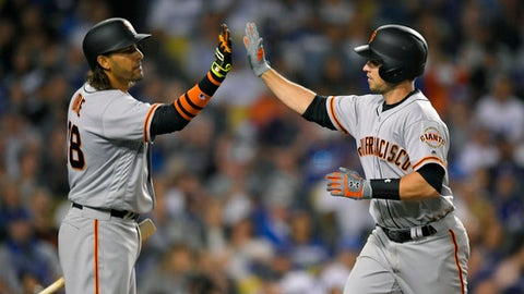 San Francisco Giants' Buster Posey, right, is congratulated by Michael Morse after hitting a solo home run during the third inning of a baseball game against the Los Angeles Dodgers, Monday, May 1, 2017, in Los Angeles. (AP Photo/Mark J. Terrill)