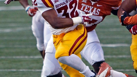 FILE - In this Oct. 15, 2016, file photo, Iowa State running back David Montgomery (32) runs during the first half of an NCAA college football game against Texas, in Austin, Texas. Montgomery averaged 5.2 yards per carry and closed the season with 141 yards against West Virginia. (AP Photo/Michael Thomas, File)