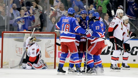 Ottawa Senators goalie Craig Anderson (41) and teammate Ben Harpur (67) look away as the New York Rangers celebrate a goal by Michael Grabner during the first period of Game 3 of an NHL hockey Stanley Cup second-round playoff series Tuesday, May 2, 2017, in New York. (AP Photo/Frank Franklin II)