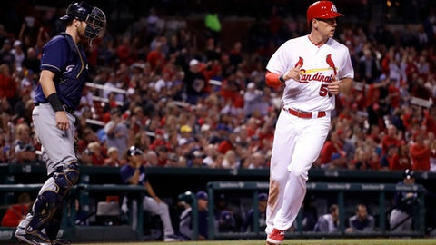 St. Louis Cardinals' Stephen Piscotty, right, scores past Milwaukee Brewers catcher Jett Bandy during the sixth inning of a baseball game Tuesday, May 2, 2017, in St. Louis. (AP Photo/Jeff Roberson)
