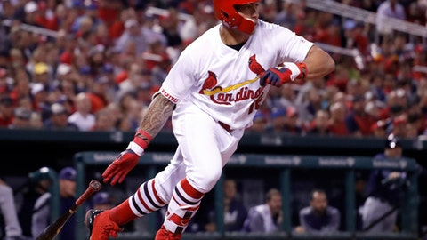 St. Louis Cardinals' Kolten Wong follows through on an RBI single during the sixth inning of a baseball game against the Milwaukee Brewers Tuesday, May 2, 2017, in St. Louis. (AP Photo/Jeff Roberson)