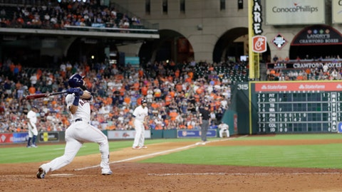 Houston Astros' Marwin Gonzalez hits a grand slam against the Texas Rangers during the eighth inning of a baseball game, Tuesday, May 2, 2017, in Houston. (AP Photo/David J. Phillip)