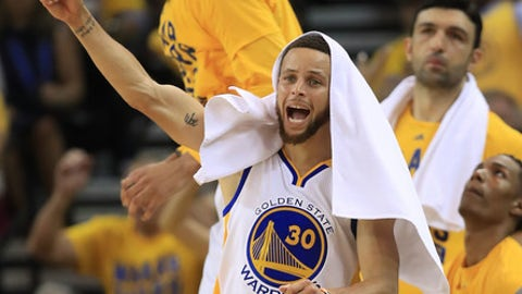 OAKLAND, CA - MAY 02:  Stephen Curry #30 of the Golden State Warriors reacts after a basket by a teammate against the Utah Jazz during Game One of the NBA Western Conference Semi-Finals at ORACLE Arena on May 2, 2017 in Oakland, California.  NOTE TO USER: User expressly acknowledges and agrees that, by downloading and or using this photograph, User is consenting to the terms and conditions of the Getty Images License Agreement.  (Photo by Ezra Shaw/Getty Images)